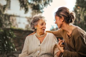 elderly woman and young woman